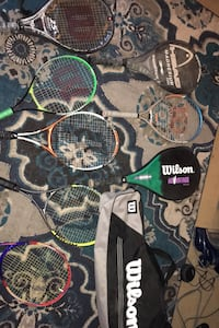 8 tennis rackets and a Wilson case