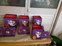four purple ghost printed boxes