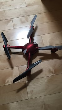Red and black quadcopter drone