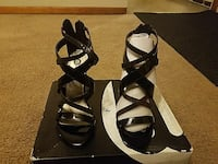pair of black leather open-toe heeled sandals