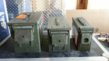 tree green ammunition boxes