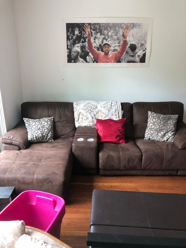 Two piece sectional w/ middle console and cup holders