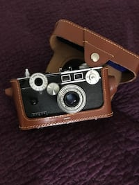 Brown and black leather wallet and film camera San Francisco, 94107