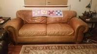 Buckskin saddle leather couch with brads
