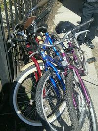 three assorted bicycles