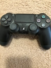 Black sony ps4 game controller Seattle, 98118