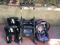 Baby's black and purple travel system