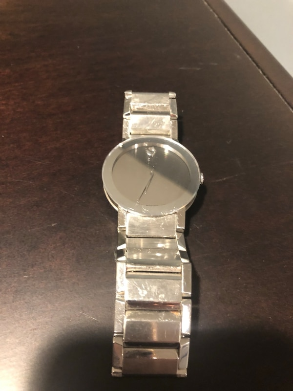 3 men's movado watches . Asking 200 for each watch.