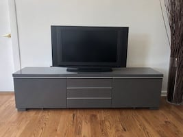 Grey TV console with storage