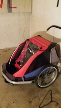 red and black bike buggy