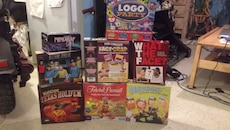 assorted board game boxes