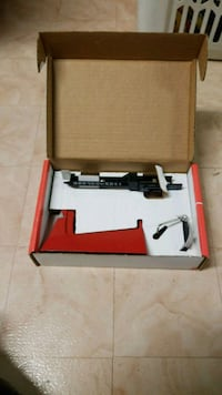 red and black airsoft rifle with box 33 km