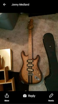 brown and black electric guitar 620 km