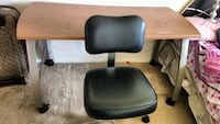 black and gray leather padded chair 407 mi