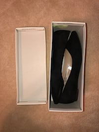 Black leather slip on shoes in box