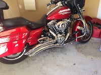 Red and black street glide motorcycle with touring package. Must sell fast. BRISTOW