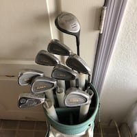 Grey and teal golf bag with golf club set Goodyear