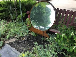 Solid round mirror which was attached to a vintage commode. Delivery
