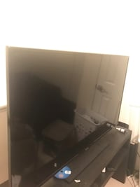 black flat screen TV with remote control Vienna, 22180