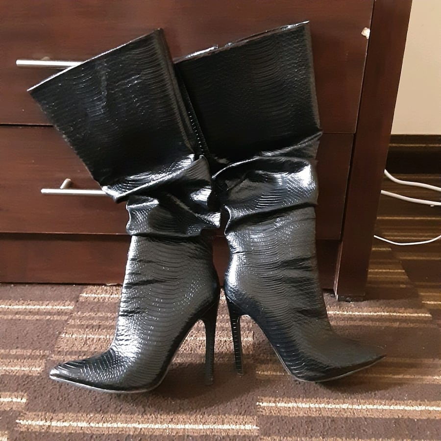 Blk stiletto boots. Snake skin faux, leather. Must letgo! Make offer? ca527565-8b51-4673-b154-a2080a6b89d1