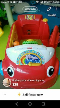 red and white Fisher-price ride-on toy