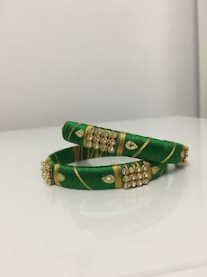 two green-brown floral studded silk thread bangles