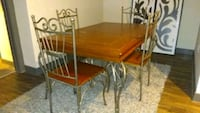 rectangular brown wooden table with four chairs dining set Henderson