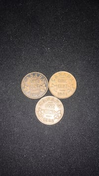 two round silver and gold coins Vancouver, V5R 1L2