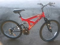 red and black full suspension mountain bike Phoenix, 85019