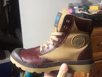 Unpaired brown and black leather boot 792 km