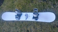 white and black snowboard with bindings Calgary, T2W 6C8