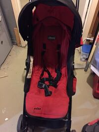 baby's red and black Chicco stroller