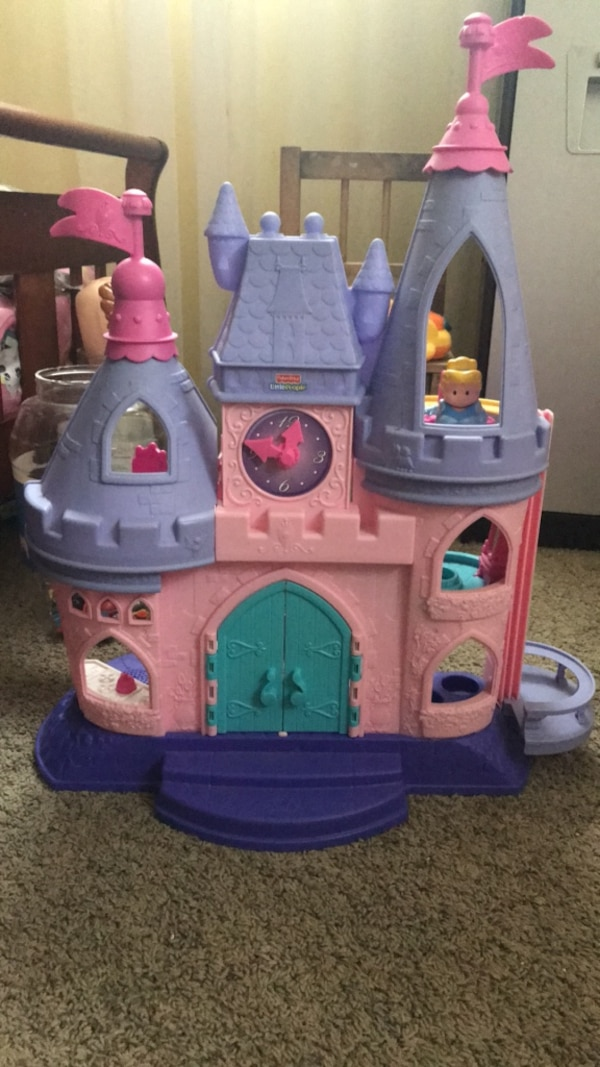 toddler's white and purple plastic castle toy