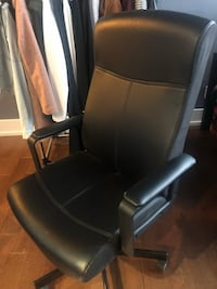 black leather padded rolling armchair Toronto, M5B 1H3