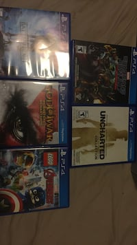 five assorted PS4 game cases
