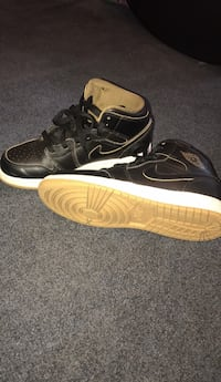 Pair of black air jordan basketball shoes Hicksville
