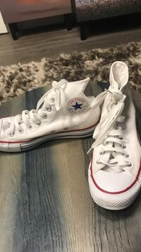 pair of white Converse All Star high-top sneakers New York, 10011