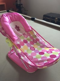 pink and white polka dot bouncer Repentigny, J6A 1H3