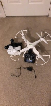 white quadcopter drone with controller Bunker Hill, 25413