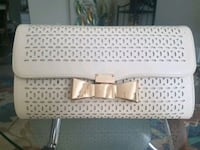 White vintage clutch purse with a gold bow Wichita, 67203