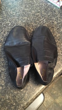 pair of black leather slip-on shoes