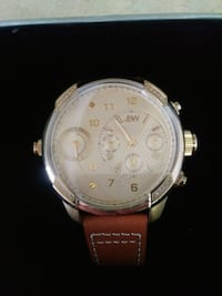 round silver chronograph watch with brown leather strap Toronto, M6A