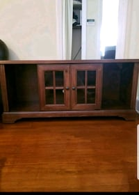TV stand with sliding shutter
