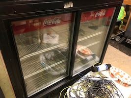 Coke refrigerator with sliding doors on both sides.  Does not run.