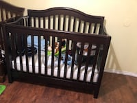 Baby's brown wooden crib and mattress Tampa, 33635