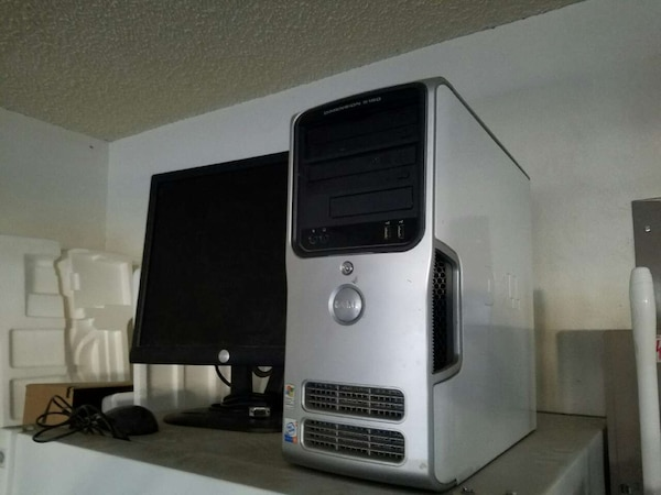 grey Dell computer tower and Dell flat screen comp