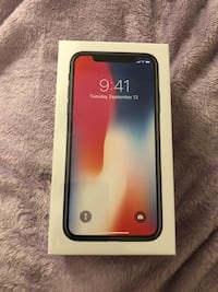 iPhone X 64 gb Black brand new in sealed box. 2 cases include