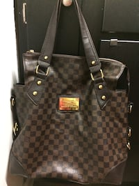 Black and brown louis vuitton leather tote bag Murfreesboro, 37130