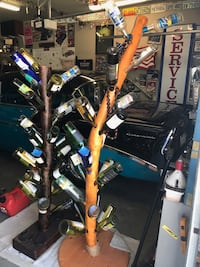 Wood tree and surf board wine bottle sculpture/ bottles on sculpture on empty but will hold full bottles Riverbank, 95367