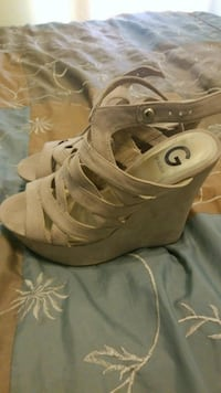 pair of brown Guess ghillie wedge sandals